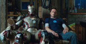 iron man suit and tony stark sitting