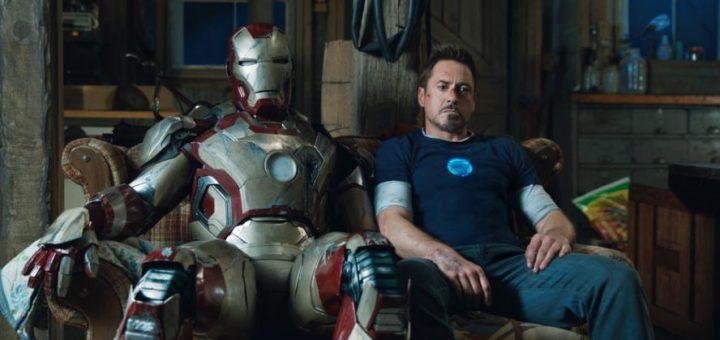 iron man suit and tony stark sitting